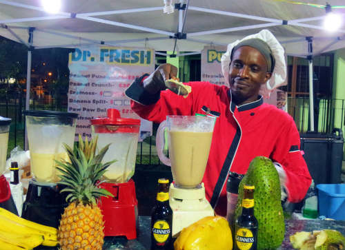 Photo: Smoothie vendor, Dr Fresh, operates his stall in the Queen's Park Savannah, Port of Spain. (Copyright flight centre.ca)