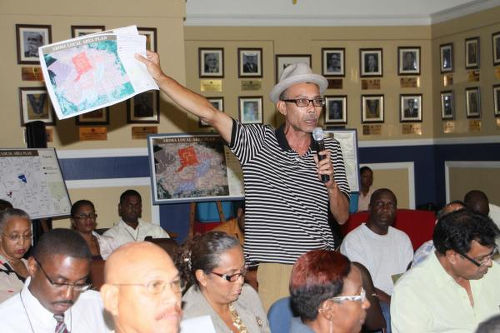 Photo: A resident speaks during a town meeting in Arima. (Courtesy News.Gov.TT)