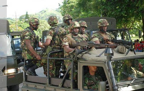 Photo: Trinidad and Tobago soldiers on the move during joint patrols with the police. (Copyright Baltimore Examiner)