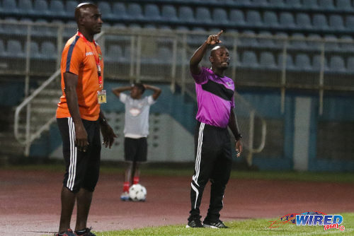 Photo: Central FC coach Dale Saunders (right) signals to his squad while San Juan Jabloteh coach Keith Jeffrey looks on during 2015/16 Pro League action at the Ato Boldon Stadium, Couva. (Courtesy Chevaughn Christopher/Wired868)
