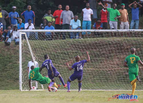 Photo: Guaya United winger Kheelon Mitchell (left) lunges in to take the ball across the goal line while Defence Force players Javon Neptune (centre) and Dwight Scott look on during 2015/16 CNG National Super League action yesterday in Guayaguare. (Courtesy Nicholas Bhajan/Wired868)