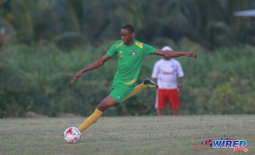Photo: Guaya United winger Reon Nelson prepares to whip in a cross against Defence Force during 2015/16 CNG National Super League action yesterday in Guayaguare. (Courtesy Nicholas Bhajan/Wired868)