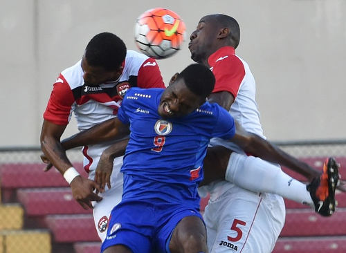 Photo: Haiti striker Kervons Belfort (centre) tangles with Trinidad and Tobago defender Daneil Cyrus (right) and his teammate during this evening's 2016 Copa America Play Off in Panama City. Belfort claimed the decisive goal as Haiti edged Trinidad and Tobago 1-0. (Copyright Rodrigo Arangua/AFP 2016)