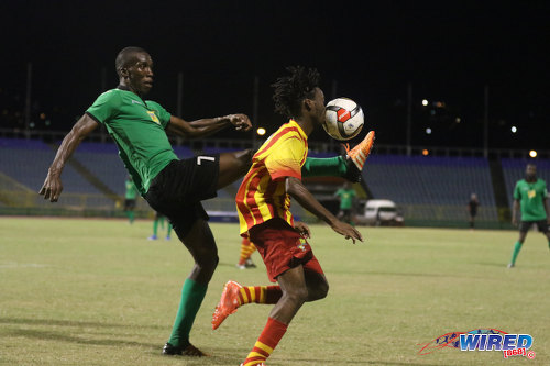 Photo: San Juan Jabloteh forward Jamal Gay (left) flicks the ball into the face of Point Fortin Civic midfielder Akeem Redhead during 2015/16 Pro League action yesterday at the Hasely Crawford Stadium. (Courtesy Chevaughn Christopher/Wired868)