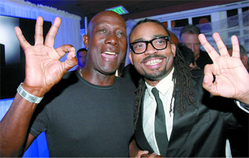 Photo: Prime Minister Dr Keith Rowley (left) poses with soca star Machel Montano during the 2016 Carnival period. (Copyright Trinidad Guardian)