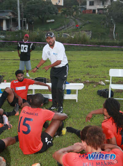 Photo: Real Maracas coach Michael McComie (standing) talks to his team at halftime during 2015/16 CNG NSL Premiership action against Stokely Vale yesterday at the Maracas Recreation Ground. (Courtesy Nicholas Bhajan/Wired868)