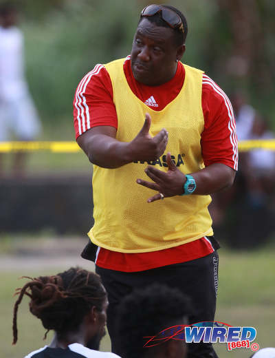 Photo: Petrotrin Palo Seco coach Dexter Cyrus makes a point during halftime in CNG National Super League Premiership Division action against Matura ReUnited at the Matura Recreation Ground on 14 January 2016. (Courtesy Nicholas Bhajan/Wired868)