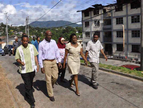 Photo: Then Opposition Leader Dr Keith Rowley (second from left) and MP Donna Cox (centre) walk through Troumacaque, Laventille. (Copyright news.gov.tt)
