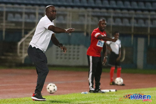 Photo: St Ann's Rangers coach Angus Eve (left) and Central FC coach Dale Saunders gesture during 2015/16 Pro League action yesterday. (Courtesy Chevaughn Christopher/Wired868)