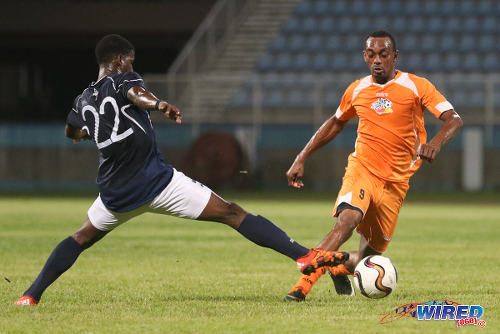 Photo: Club Sando midfielder Jesse Downing (right) takes on Morvant Caledonia United utility player Jameel Neptune during 2015/16 Pro League action last night at the Ato Boldon Stadium, Couva. (Courtesy Chevaughn Christopher/Wired868)