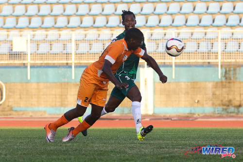 Photo: Club Sando striker Devon Mitchell heads home the game winner while W Connection player Gerard Williams (background) looks on during 2015/16 Pro League action yesterday. (Courtesy Chevaughn Christopher/Wired868)