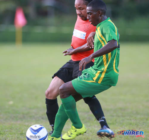 Photo: Stokely Vale winger Kerwin Joseph (right) tries to squeeze past Real Maracas playmaker Ricardo Bennett during 2015/16 CNG NSL Premiership action yesterday at the Maracas Recreation Ground. (Courtesy Nicholas Bhajan/Wired868)