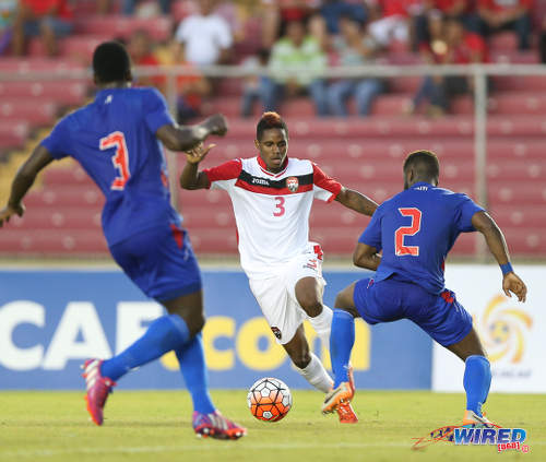 Photo: Trinidad and Tobago winger Joevin Jones (centre) tries to find a way past Haiti defenders Stéphane Lambèse (right) and Méchack Jérome during the 2016 Copa America play off contest at the Rommel Fernandez Stadium, Panama City.  (Courtesy Allan V Crane/CA-images/Wired868)