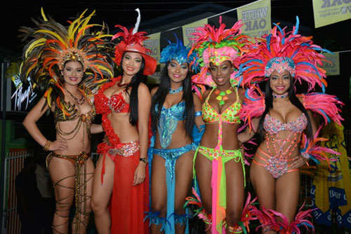 Photo: Masqueraders from the Carnival Flirt band show off their costumes. (Copyright Trini Jungle Juice)