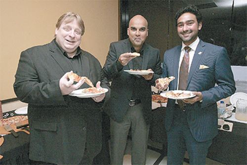 Photo: Prestige Holdings CEO Charles Pashley (left), T&T Pizza Hut vice-president Navin Maharaj (centre) and Chaguanas Chamber of Commerce president Richie Sookhai. (Copyright Trinidad Guardian)