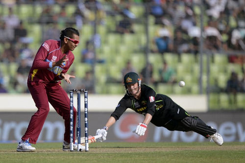 Photo: Australian captain George Bailey (right) avoids a run-out by West Indies cricketer Sunil Narine during the ICC World Twenty20 tournament Group 2 cricket match between Australia and West Indies at The Sher-e-Bangla National Cricket Stadium in Dhaka on 28 March 2014.  (Copyright AFP 2016/Munir uz Zaman)
