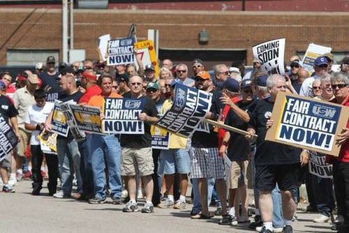 Photo: Steel workers protest at an ArcelorMittal plant in Chicago. (Copyright Chicago Times)
