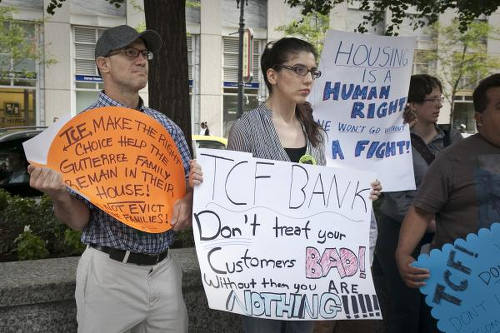 Photo: Home owners protest against bank foreclosures in Chicago. (Copyright ProgressIllinois)
