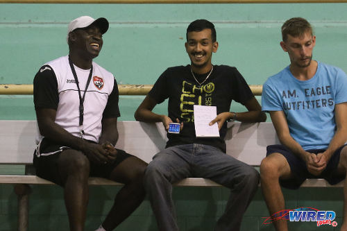 Photo: Trinidad and Tobago National Futsal Team Clayton Morris (left) has a laugh with Wired868 reporter Amiel Mohammed (centre) during an interview at the Maloney Indoor Sport Arena. (Courtesy: Chevaughn Christopher/CA-images/Wired868)