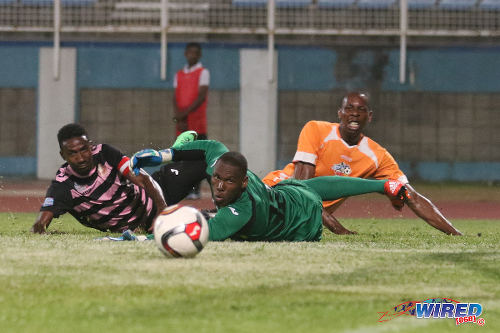 Photo: Club Sando striker Kevon Woodley (right) and North East Stars players Keryn Navarro (left) and goalkeeper Glenroy Samuel watch an effort flash just wide during their TT Pro League clash at the Ato Boldon Stadium on 1 March 2016. (Courtesy Chevaughn Christopher/Wired868)