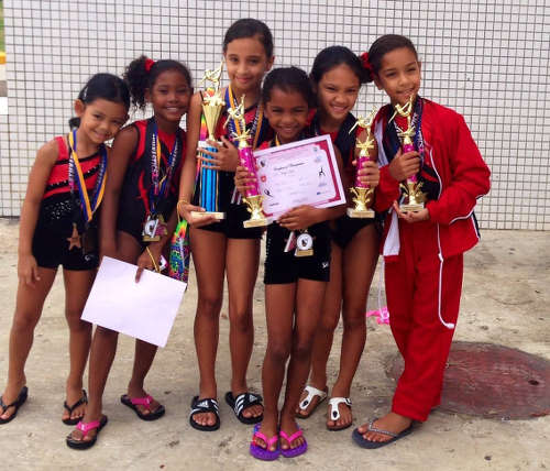 Photo: Young Tots and Tumblers gymnasts show off their winnings.