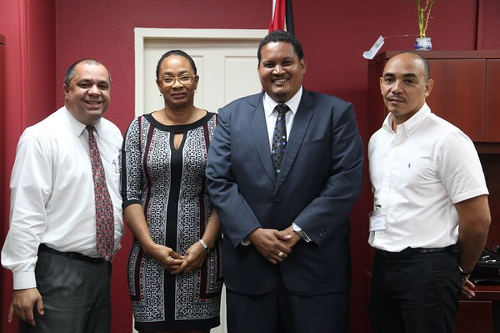 Photo: Trinidad and Tobago Gymnastics Federation officials (from right) Ricardo Lue Shue, Elicia Peters-Charles and David Marquez pose with Sport Minister Darryl Smith (second from right). (Courtesy Ministry of Sport and Youth Affairs)