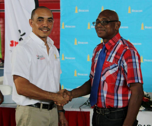 Photo: Trinidad and Tobago Gymnastics Federation second vice president and former president Ricardo Lue Shue (left) shakes hands with SPORTT Company official Anthony Creed. Lue Shue will act as Marisa Dick's coach in Brazil. (Courtesy SPORTT)