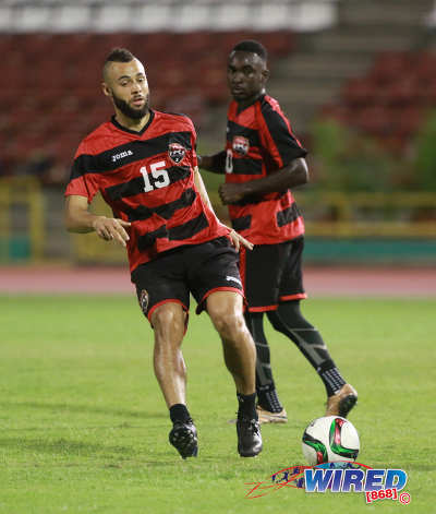 Photo: Trinidad and Tobago midfielder John Bostock (left) trains with the national team while Trevin Caesar looks on at the Hasely Crawford Stadium on 21 March 2016. (Courtesy Nicholas Bhajan/Wired868)