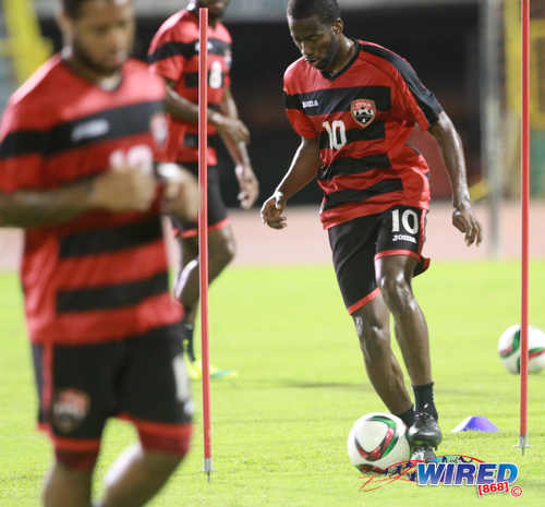 Photo: Trinidad and Tobago international midfielder Kevin Molino (right) trains with his teammates at the Hasely Crawford Stadium on 21 March 2015. (Courtesy Nicholas Bhajan/Wired868)
