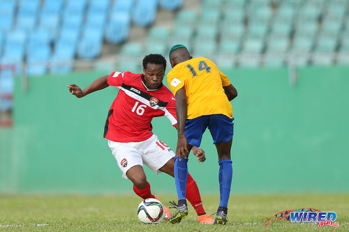 Photo: Trinidad and Tobago winger Levi Garcia (left) prepares to glide past St Vincent and the Grenadines right back Akeem Williams en route to his opening goal in Russia 2018 World Cup qualifying action at Arnos Vale on 25 March 2016. Trinidad and Tobago won 3-2. (Courtesy Allan V Crane/CA-images/Wired868)