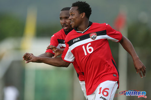 Photo: Eighteen year old Trinidad and Tobago winger Levi Garcia (right) celebrates his second goal with teammate Khaleem Hyland against St Vincent and the Grenadines at Arnos Vale on 25 March 2016. Trinidad and Tobago won 3-2. (Courtesy Allan V Crane/CA-images/Wired868)