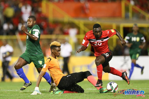 Photo: Trinidad and Tobago forward Trevin Caesar (right) takes the ball around St Vincent and the Grenadines goalkeeper Lemus Christopher during Russia 2018 World Cup qualifying action at the Hasely Crawford Stadium, Port of Spain on 29 March 2016. Trinidad and Tobago won 6-0. (Courtesy: Allan V Crane/CA-images/Wired868)