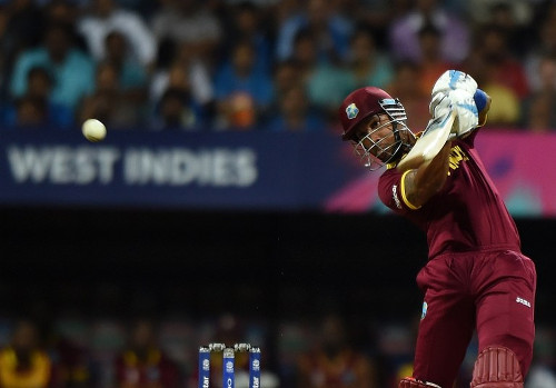 Photo: West Indies batsman Lendl Simmons plays a shot during the World T20 semi-final match against India at The Wankhede Cricket Stadium in Mumbai on 31 March 2016. (Copyright AFP 2016/Punit Paranjpe)