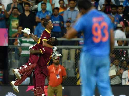 Photo: West Indies cricketer Lendl Simmons (left) celebrates after winning the World T20 cricket tournament semi-final match against India at The Wankhede Cricket Stadium in Mumbai on 31 March 2016. (Copyright AFP 2016/Punit Paranjpe)