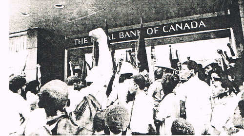 Photo: A public demonstration outside of the Royal Bank of Canada in 1970. (Courtesy NJAC)