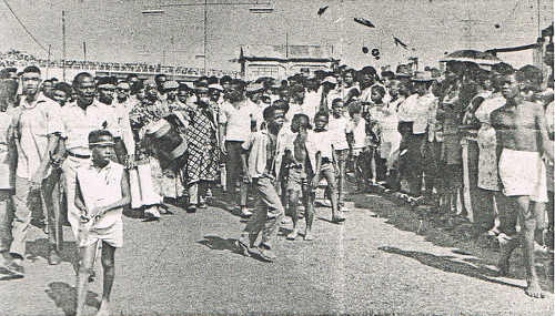 Photo: Mourners march to the sounds of African and Indian drums during the funeral procession for Basil Davis on 9 April 1970. (Courtesy Embau Moheni/NJAC)