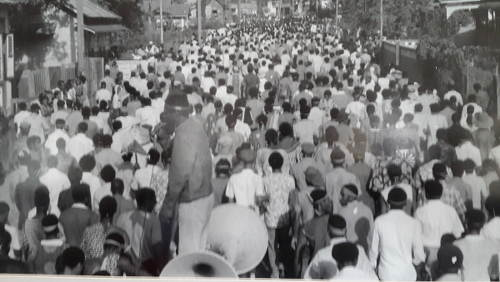 Photo: Mourners march through Port of Spain during the funeral procession for Basil Davis on 9 April 1970. (Courtesy Embau Moheni/NJAC)
