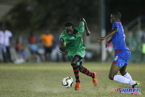 Photo: San Juan Jabloteh winger Nathan Lewis (left) tries to evade St Ann's Rangers defender Shakiyl Phillip during Pro League action at the Barataria Recreation Ground on 2 April 2016. Phillip will also represent Jabloteh in 2017. (Courtesy Allan V Crane/CA-images/Wired868)