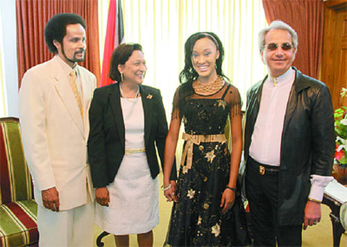 Photo: Then Prime Minister Kamla Persad-Bissessar (second from left) poses with (from left) Pastor Winston Cuffie, his daughter Winsie-Ann Cuffie and US evangelist Benny Hinn. Mr Live Wire has no way of knowing whether Tanty Kamla is thinking: Okay, which one of you suckers can turn water into wine?! (Copyright Trinidad Guardian)