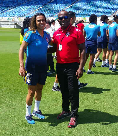 Photo: Former Trinidad and Tobago technical director Kendall Walkes (right) poses with Brazil international star Marta in Natal in December 2015.