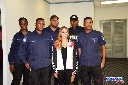 Photo: Trinidad and Tobago gymnast Marisa Dick (centre) was accompanied by five police officers at the Trinidad and Tobago Gymnastics Federation (TTGF) press conference on 20 April 2016 at the Chamber of Commerce in Westmoorings. (Courtesy Wired868)