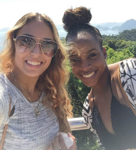 Photo: Trinidad and Tobago gymnasts Thema Williams (right) and Marisa Dick pose for a photograph while sightseeing in Rio, after the Olympic Test event on 17 April 2016. (Courtesy Hannifer Dick)