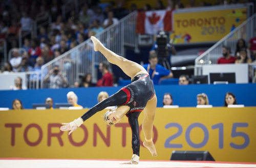 Photo: Trinidad and Tobago gymnast Marisa Dick competes on the floor exercise in the women's artistic gymnastics team event at the 2015 Pan American Games in Toronto, Canada on 12 July 2015. (Copyright AFP 2016/Kevin Van Paassen)