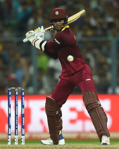 Photo: West Indies and Jamaica all-rounder Marlon Samuels plays a shot during the World T20 cricket tournament final match between England and West Indies at The Eden Gardens Cricket Stadium in Kolkata on 3 April 2016. Samuels was the man of the match as West Indies won by four wickets. (Copyright AFP2016/Dibyangshu Sarkar)