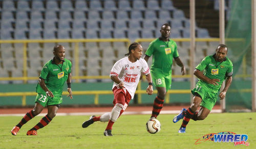 Photo: Central FC midfielder Nathaniel Garcia runs with the ball while San Juan Jabloteh players (from left) Kennedy Hinkson, Keyon Edwards and Damian Williams keep watch during Pro League action on 17 May 2016 at the Hasely Crawford Stadium in Port of Spain. Jabloteh won 3-2. (Courtesy Nicholas Bhajan/Wired868)