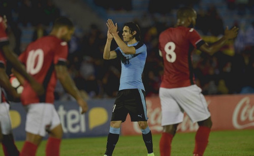 Photo: Uruguay star striker Edinson Cavani (centre) applauds the crowd after his goal against Trinidad and Tobago during friendly international action at the Centenario Stadium in Montevideo on 27 March 2016. Cavani scored twice as Uruguay won 3-1. (Copyright Miguel Rojo/AFP 2016)