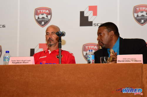 Photo: Former Trinidad and Tobago National Senior Team head coach Stephen Hart (left) and Trinidad and Tobago Football Association (TTFA) president David John-Williams enjoy each other's company during a press conference at the Hyatt Regency hotel in Port of Spain on 19 May 2016. (Courtesy Wired868)