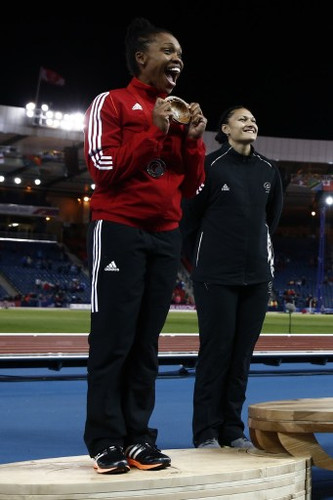Photo: Trinidad and Tobago's Cleopatra Borel (left) celebrates her silver finish at the Glasgow 2014 Commonwealth Games alongside gold medalist Valerie Adams (New Zealand) at Hampden Park on 30 July 2014. (Copyright Adrian Dennis/AFP 2016/Wired868)
