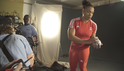 Photo: Cleopatra Borel (right) prepares for a TSTT photo shoot during a pre-2016 Olympic Games sponsorship engagement. (Copyright TSTT)