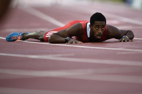 Photo: Trinidad and Tobago's Jehue Gordon lies on track after finishing second in the final of the men's 400m hurdles athletics event at Hampden Park during the 2014 Commonwealth Games in Glasgow, Scotland on 31 July 2014. (Copyright AFP2016/Andrej Isakovic)